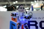 Korean singer Psy-cloned miniature robots perform Gangnam style dancing